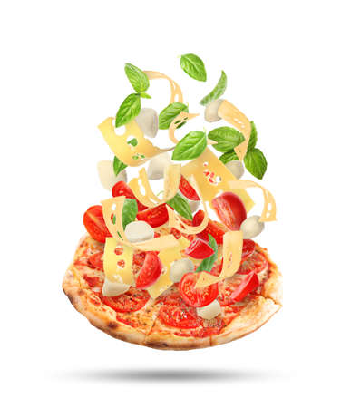 Delicious pizza with flying ingredients on white background