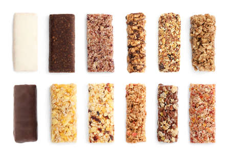 Set of different sweet protein bars on white background, top view