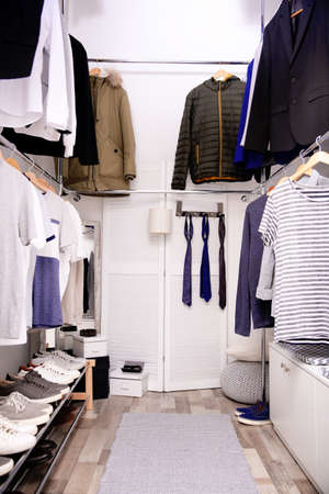 Modern dressing room with different stylish clothes and accessories