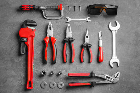 Flat lay composition with construction tools on grey background Reklamní fotografie