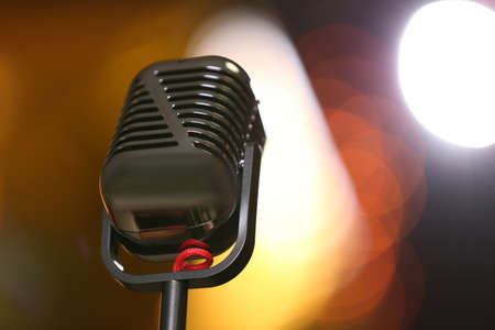 Retro microphone against festive lights, space for text. Musical equipment Banque d'images - 119679204
