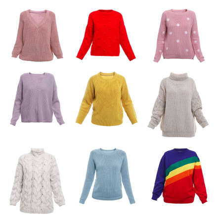 Set of different stylish warm sweaters on white background 免版税图像