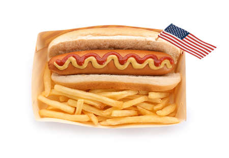 Hot dog with USA flag and French fries in paper box on white background, top view. Traditional American food Stock Photo