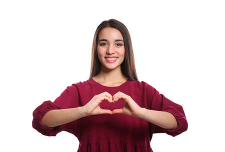 Woman showing HEART gesture in sign language on white background