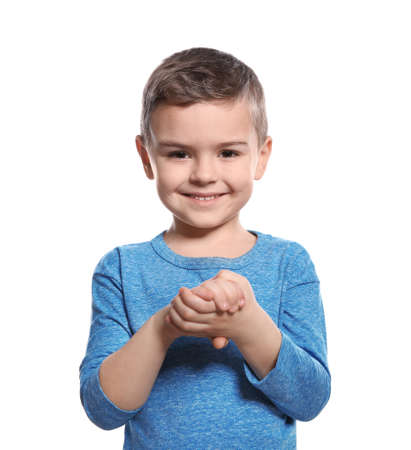 Little boy showing BELIEVE gesture in sign language on white background