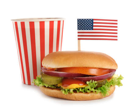 Burger with USA flag and drink on white background. Traditional American food Stock Photo