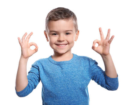 Little boy showing OK gesture in sign language on white background 스톡 콘텐츠 - 119837004