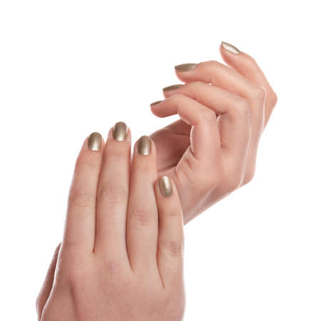 Woman showing gold manicure isolated on white, closeup. Nail polish trends Imagens