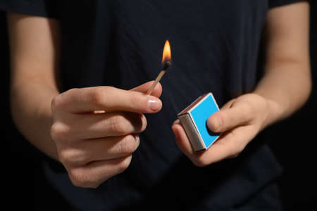 Woman with box of matches, closeup of hands