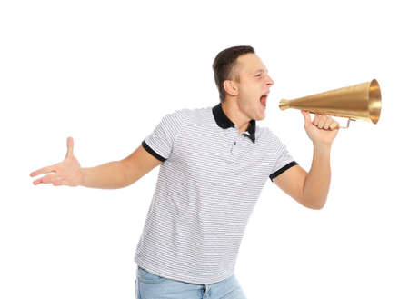 Emotional young man with megaphone on white background
