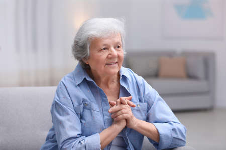 Portrait of beautiful grandmother in living room