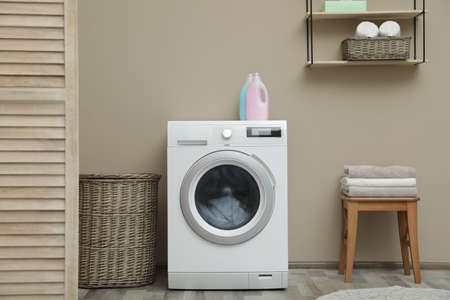 Washing machine with dirty towel in laundry room