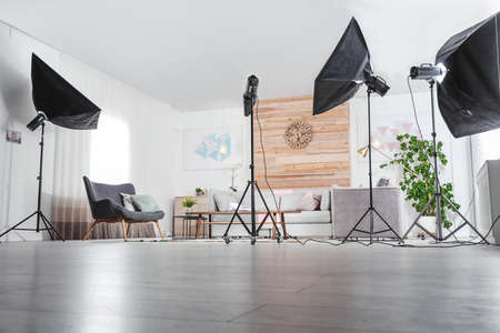Professional photo studio equipment prepared for shooting living room interior 版權商用圖片