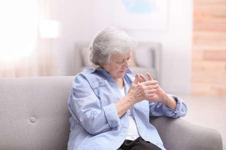 Portrait of beautiful grandmother in living room