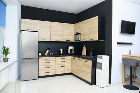 Cozy modern kitchen interior with new furniture and appliances