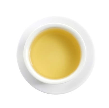 Cup of freshly brewed oolong tea on white background, top view
