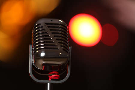 Retro microphone against festive lights, space for text. Musical equipment Banque d'images - 119966699
