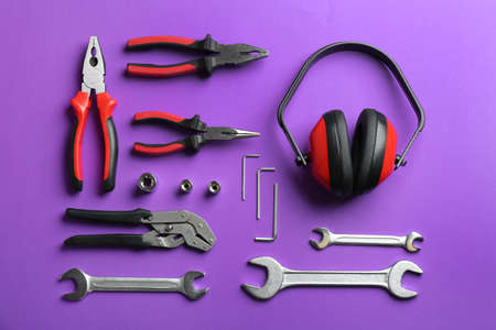 Flat lay composition with different construction tools on color background