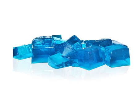 Heap of blue jelly cubes on white background