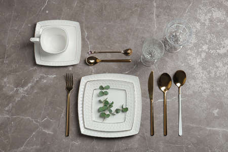 Stylish elegant table setting on marble background, top view