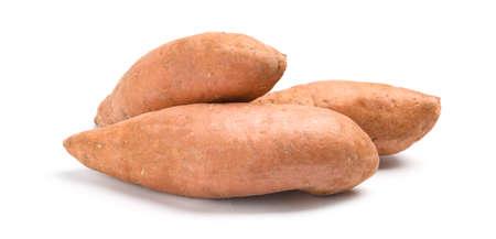 Whole ripe sweet potatoes on white background Reklamní fotografie