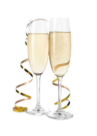 Glasses of champagne on white background. Festive drink