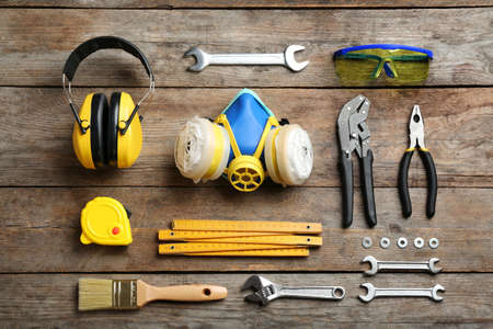 Flat lay composition with construction tools on wooden background Reklamní fotografie