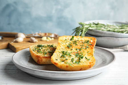 Plate with delicious homemade garlic bread on table Archivio Fotografico