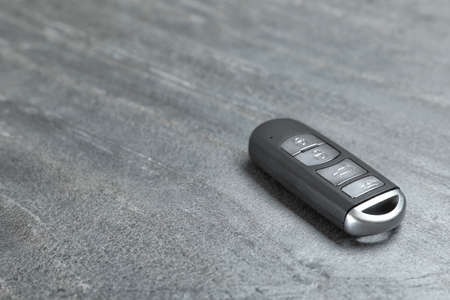 Car smart key on grey background. Space for text Фото со стока