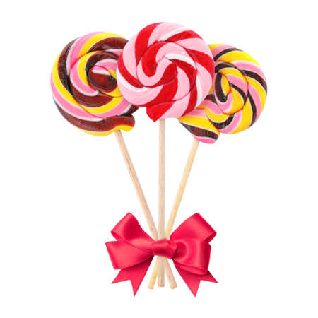 Colorful tasty candies with bow on white background
