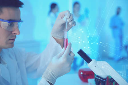 Medical student working in modern scientific laboratory, color tone Imagens