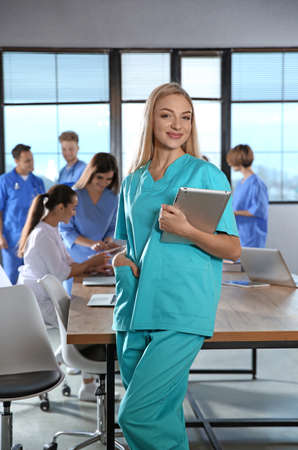 Smart medical student with her classmates in college 스톡 콘텐츠
