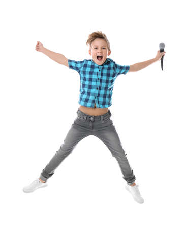 Cute boy with microphone on white background