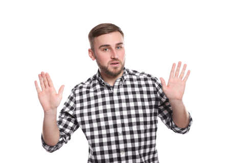 Man showing STOP gesture using sign language on white background