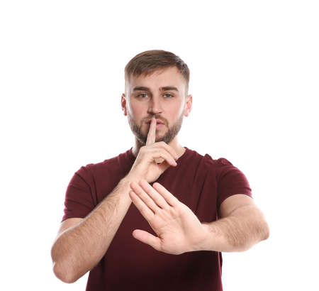 Man showing HUSH gesture in sign language on white background