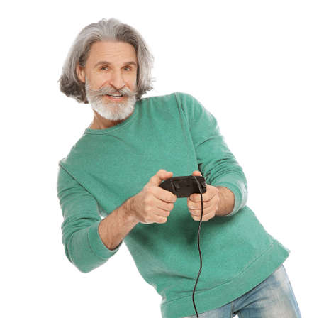 Emotional mature man playing video games with controller isolated on white background Imagens