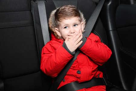 Little boy suffering from nausea in car