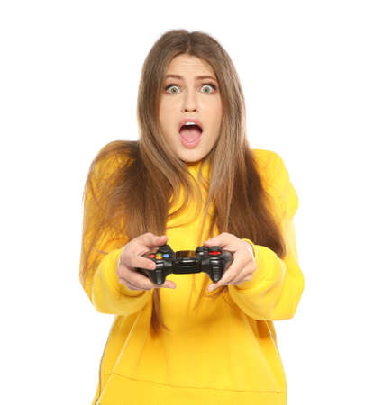 Emotional young woman playing video games with controller isolated on white background Banque d'images