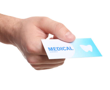 Man holding business card isolated on white, closeup. Dental medical service