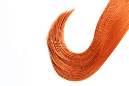 Beautiful strand of straight red hair on white background, top view. Hairdresser service