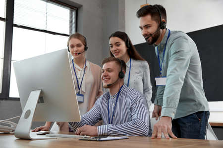 Technical support operators working in modern office