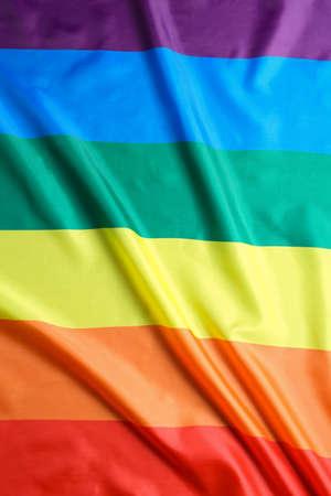 Heldere regenboogvlag als achtergrond. LGBT-gemeenschap Stockfoto