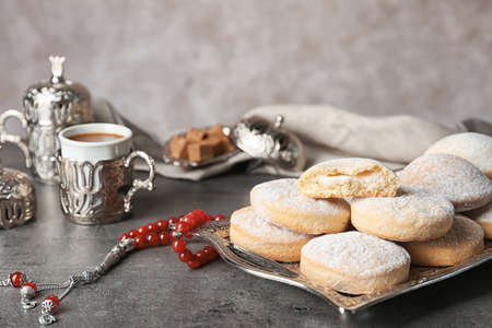 Composition with traditional cookies for Islamic holidays on table. Eid Mubarak