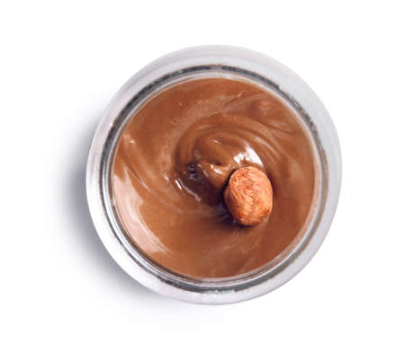 Bowl with sweet chocolate cream on white background, top view