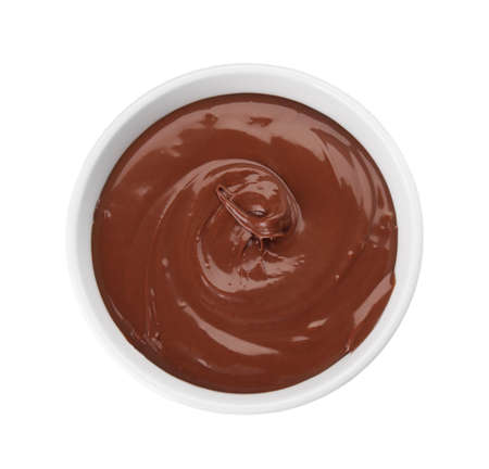 Bowl of sweet chocolate cream isolated on white, top view