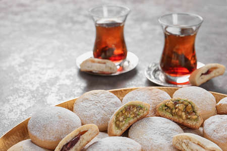 Traditional cookies for Islamic holidays and tea on table. Eid Mubarak 免版税图像