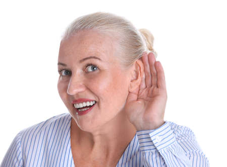 Mature woman with hearing problem on white background Reklamní fotografie - 121157581