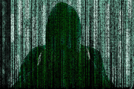 Dark silhouette of cyber criminal behind digital symbols Imagens