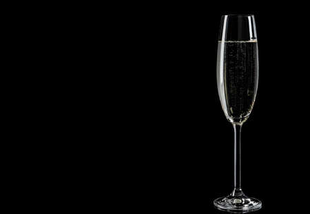 Glass of champagne on black background, space for text Banco de Imagens