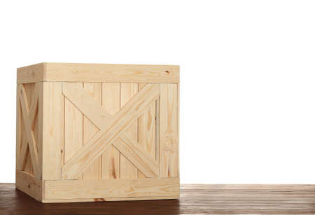 Wooden crate on table against white background. Space for text Stok Fotoğraf